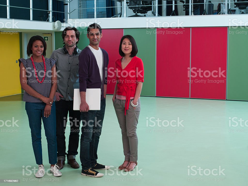 Smiling business people in empty office royalty-free stock photo