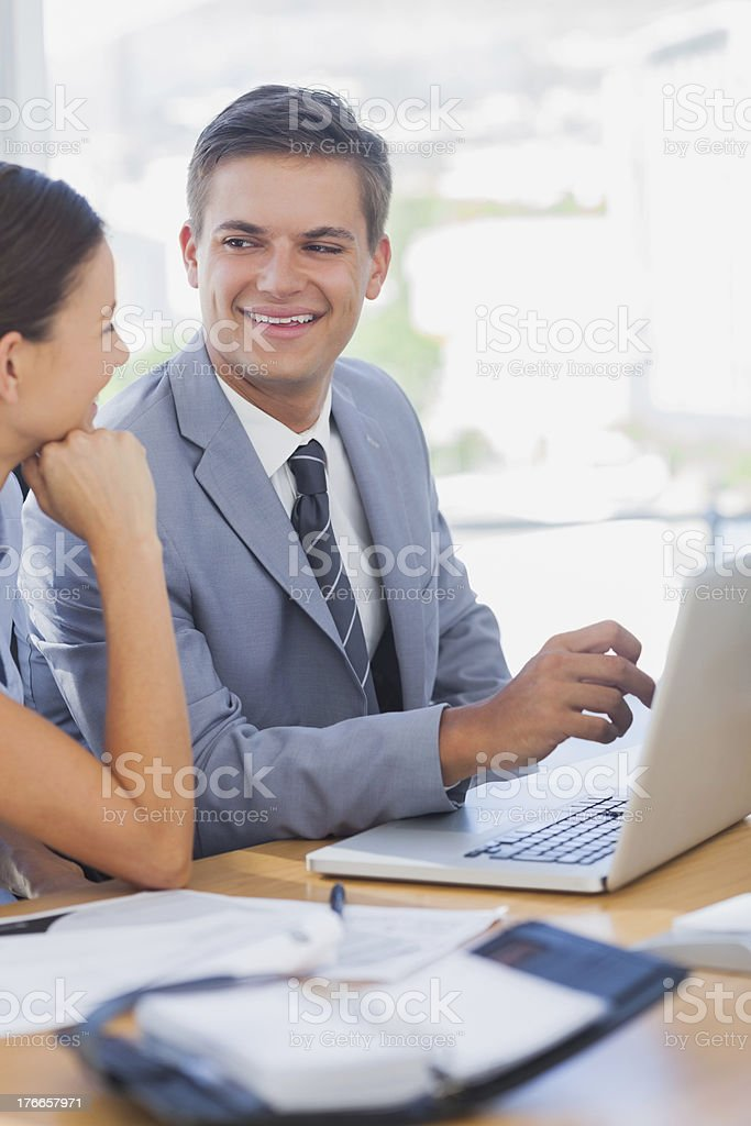 Smiling business people look at each other royalty-free stock photo
