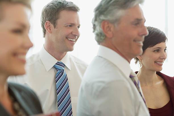 smiling business people - four lawyers stockfoto's en -beelden