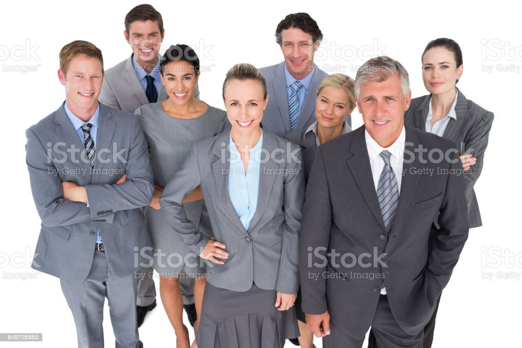 Smiling business people smiling at camera stock photo