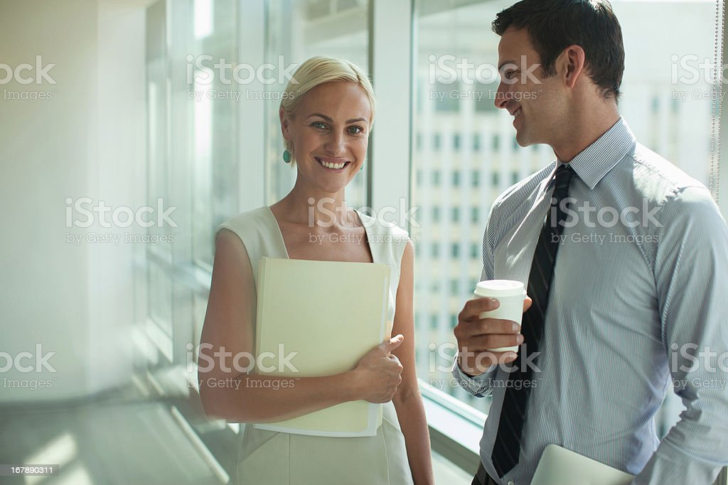 Smiling business people standing in office royalty-free stock photo