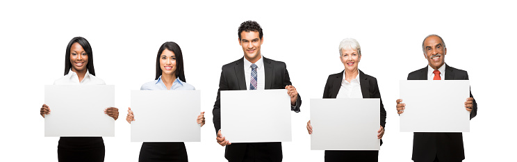 Smiling Business executives with commercial signs isolated over white background