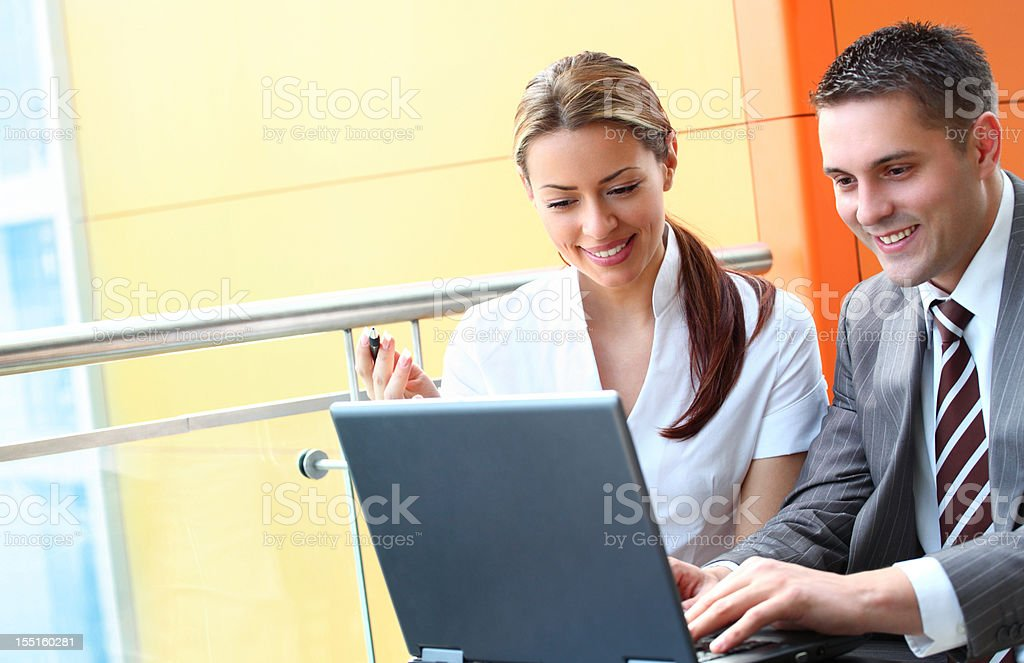 Smiling business people working on laptop. royalty-free stock photo