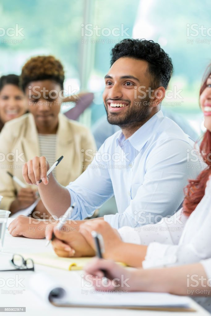 Smiling business professional attends finance conference stock photo