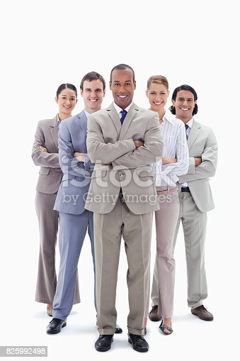 istock Smiling business team crossing their arms 825992498