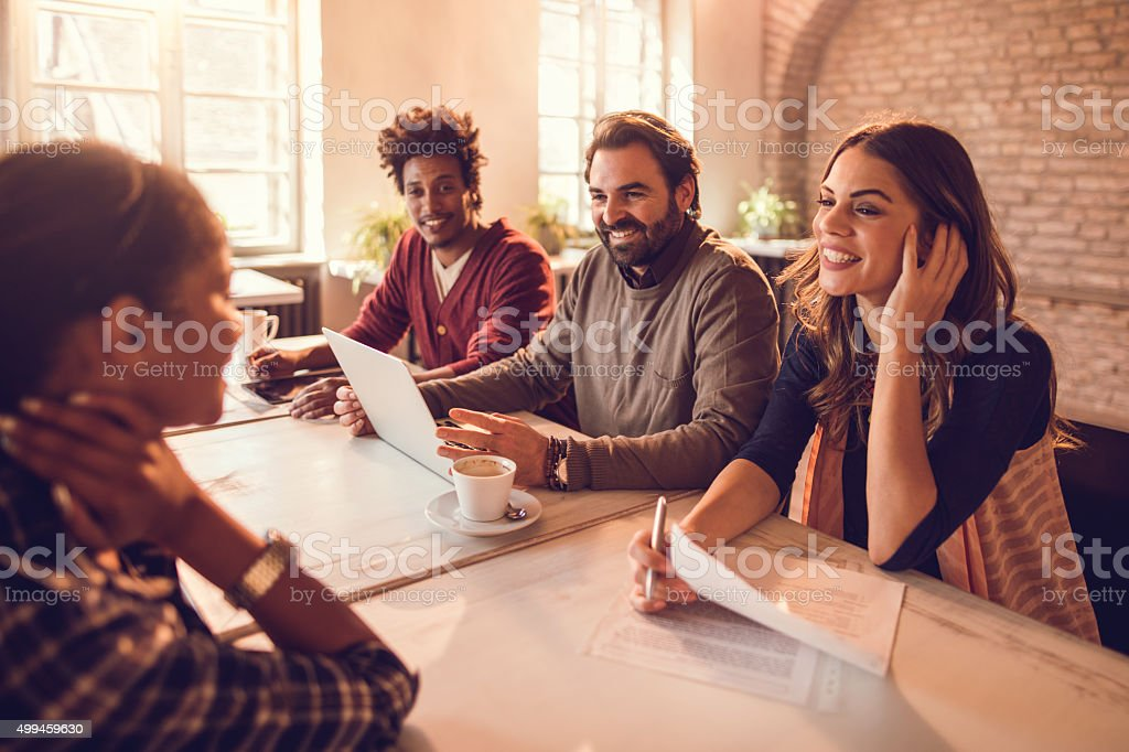 Smiling business team having a job interview with a candidate. stock photo