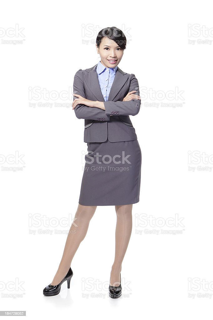 Smiling business woman cross her arms royalty-free stock photo