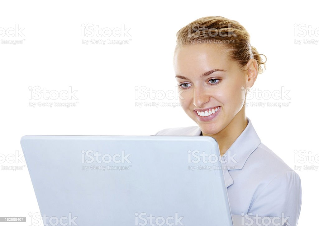 Smiling business woman getting her work done on the laptop royalty-free stock photo
