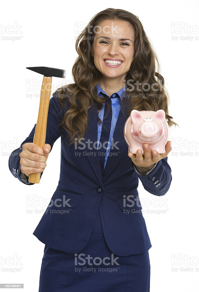 Smiling business woman giving piggy bank and hammer royalty-free stock photo