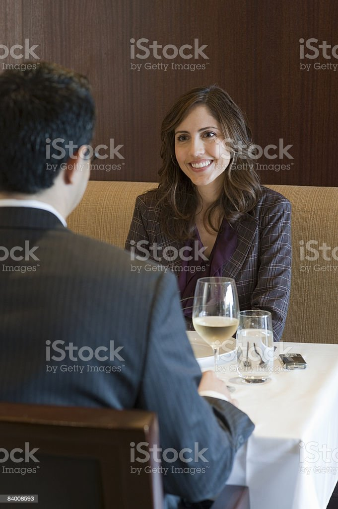 Smiling business woman has drinks in restaurant. royalty-free stock photo