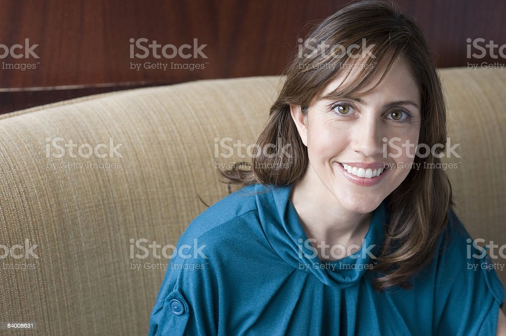 Smiling business woman in booth.  royalty-free stock photo