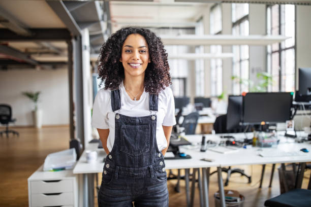 Smiling business woman in casuals stock photo
