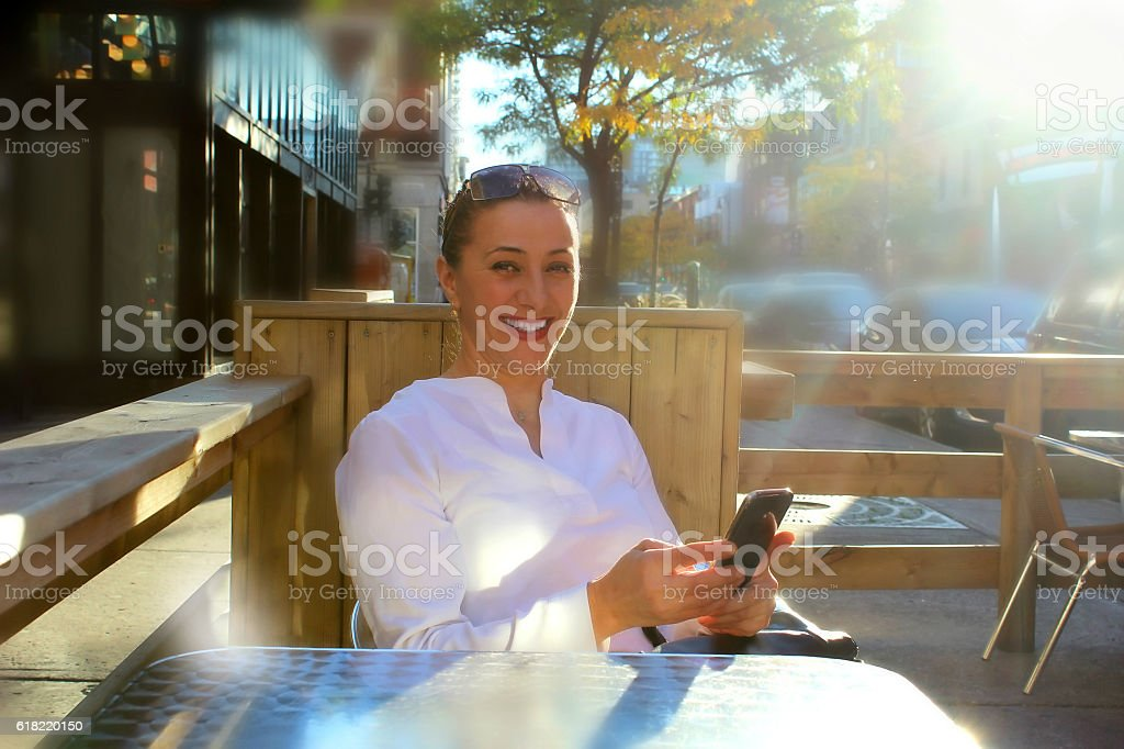 Smiling business woman in the city stock photo