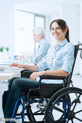 1144373653 istock photo Smiling business woman in wheelchair 905840906