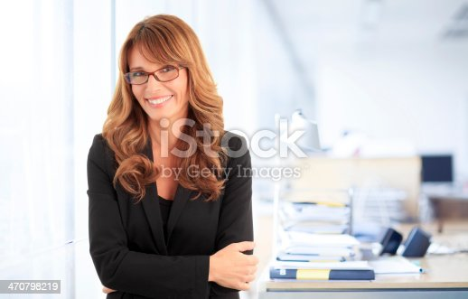 981750034istockphoto Smiling business woman 470798219