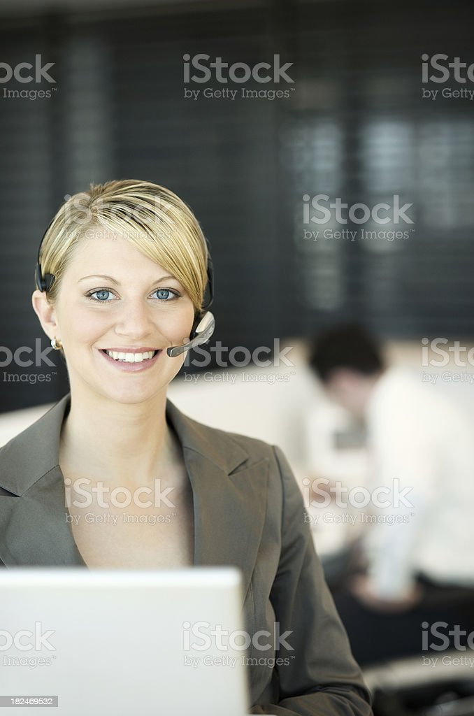 Smiling business woman receptionist royalty-free stock photo