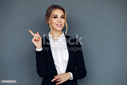 Smiling business woman showing something on her hand