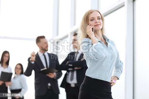 istock smiling business woman talking on her smartphone 1186445986