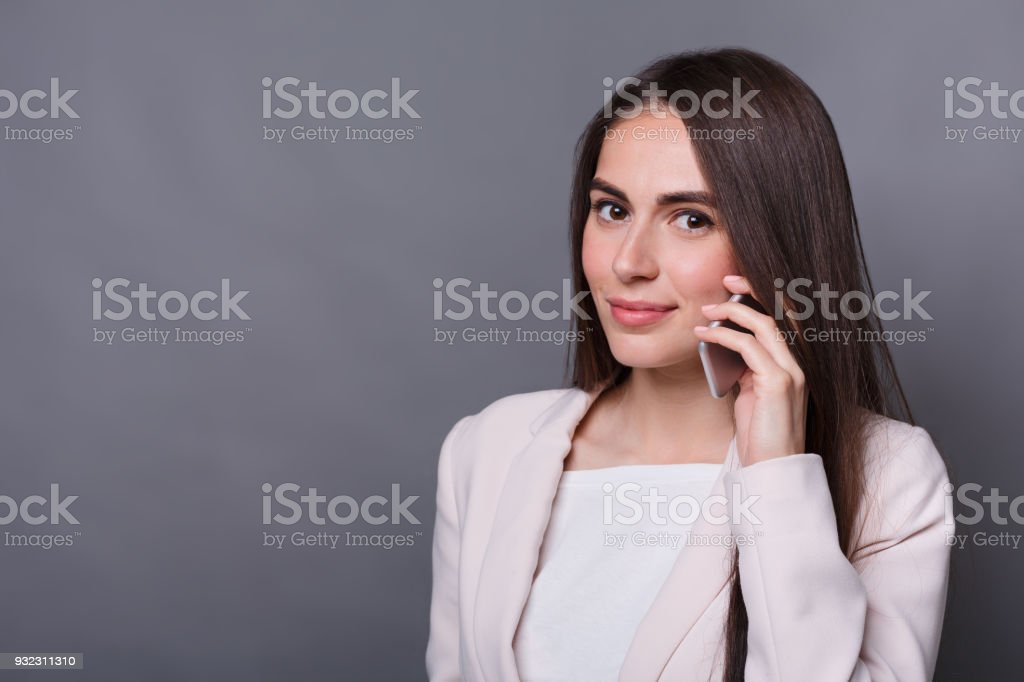 Smiling business woman talking on phone stock photo