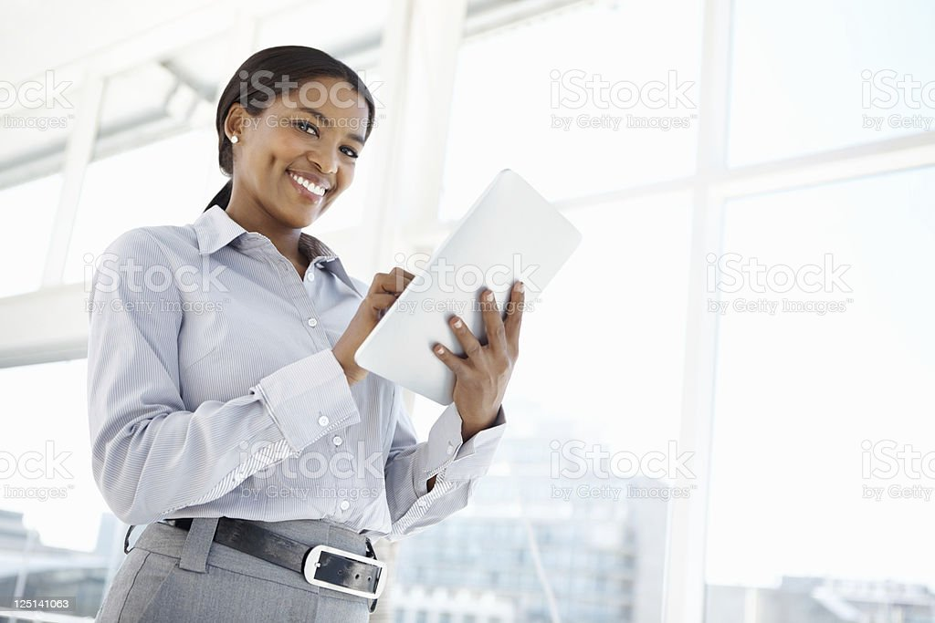 Smiling business woman using tablet PC royalty-free stock photo