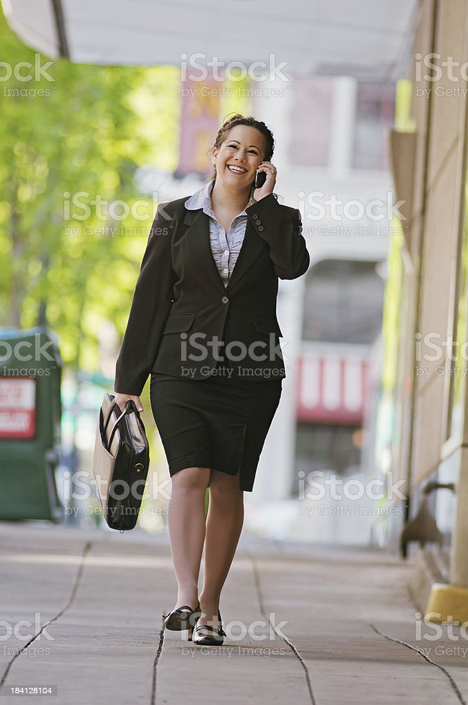 Smiling business woman walking and talking royalty-free stock photo