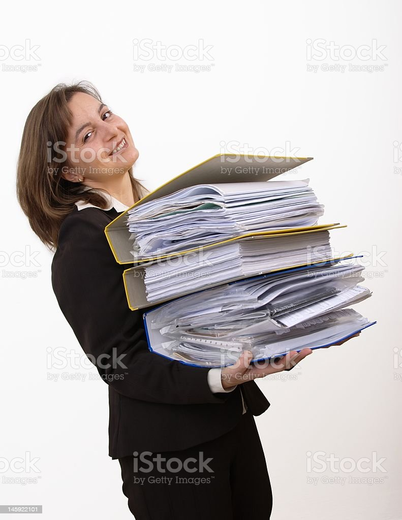 Smiling business woman wearing heavy files royalty-free stock photo
