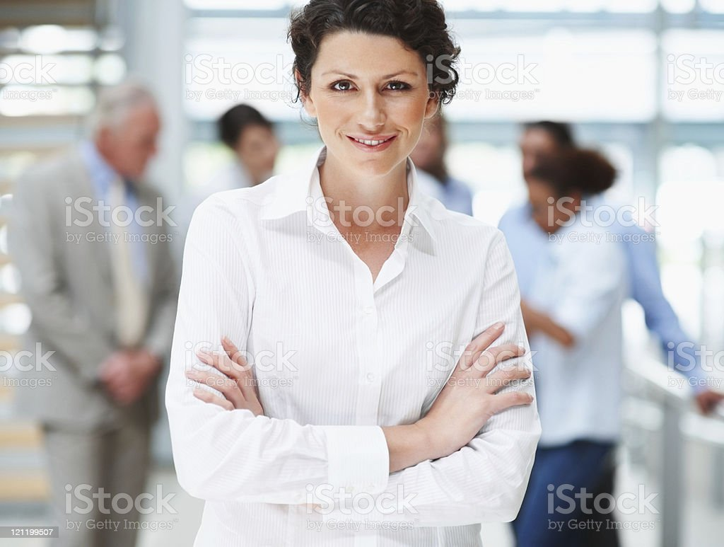 Smiling business woman with arms folded royalty-free stock photo