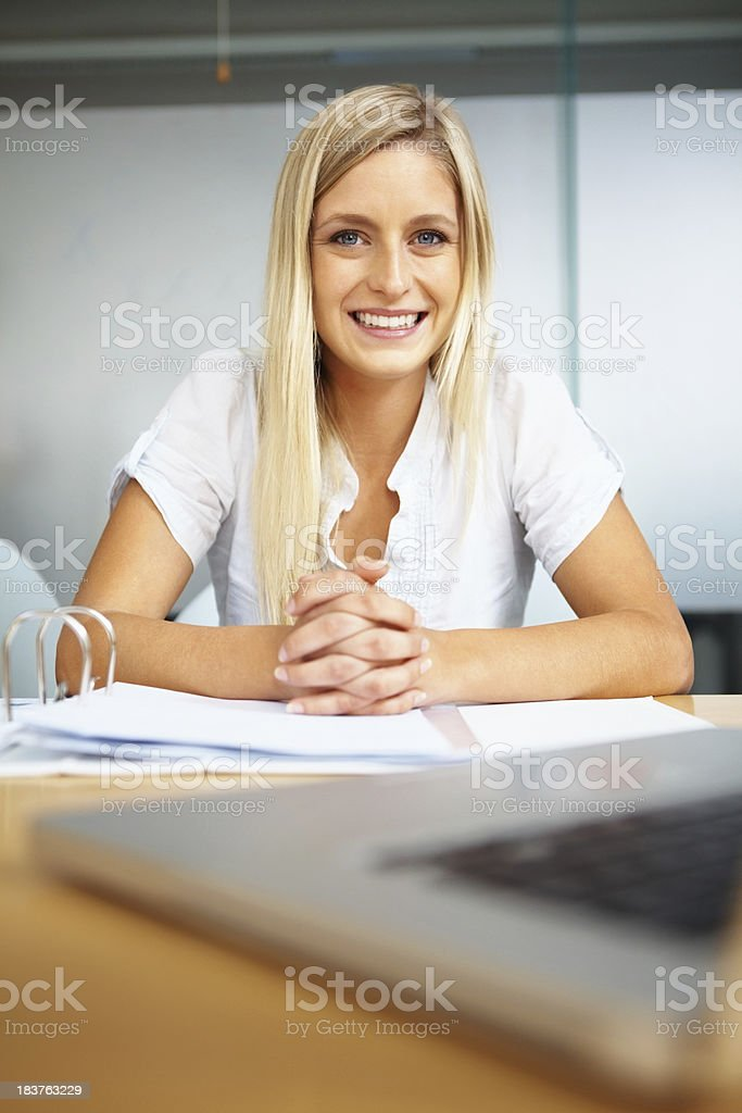 Smiling business woman with hands clasped royalty-free stock photo