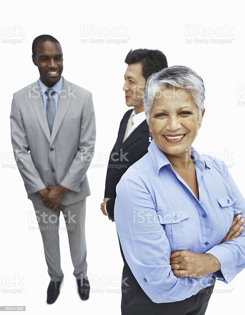 Smiling business woman with multi racial executives in background royalty-free stock photo