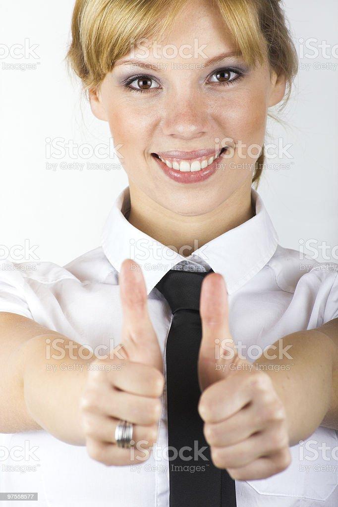 Femme d'affaires souriant avec le pouce levé photo libre de droits