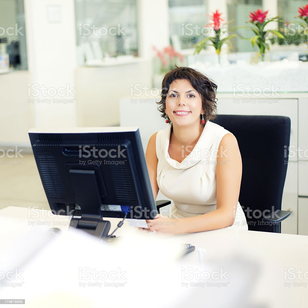 Smiling business woman working at computer. royalty-free stock photo