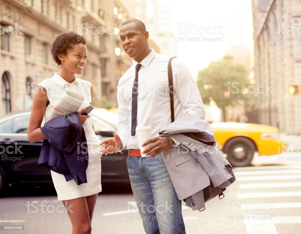 Smiling businessman and businesswoman  in New York stock photo