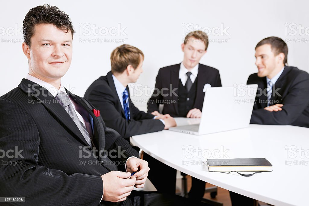 Smiling Businessman at the Team Meeting royalty-free stock photo
