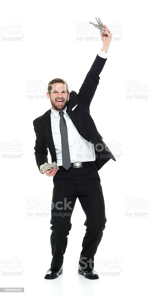 Smiling businessman cheering with money royalty-free stock photo