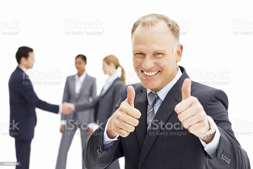 Smiling Businessman Giving the Thumbs Up - Isolated royalty-free stock photo