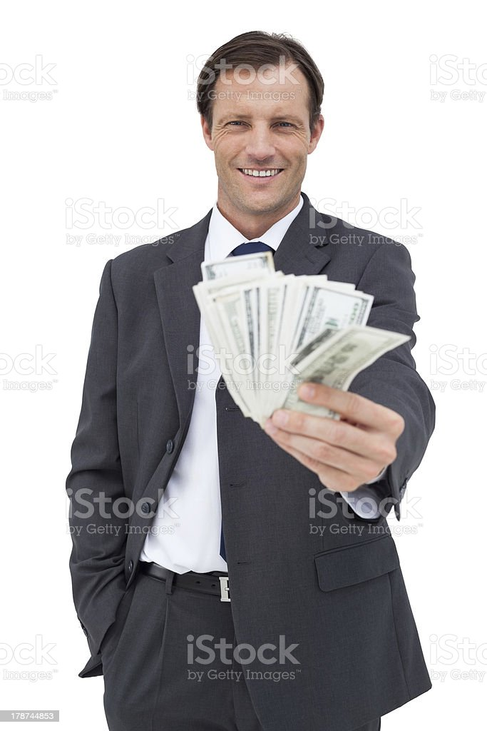 Smiling businessman holding cash royalty-free stock photo