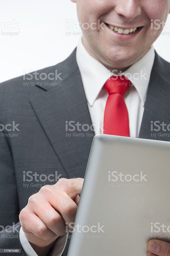 Smiling businessman holding digital tablet royalty-free stock photo