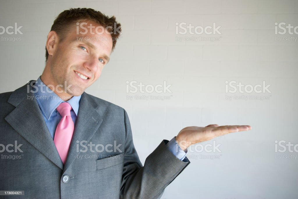 Smiling Businessman Holding Hand Out Palm Up royalty-free stock photo