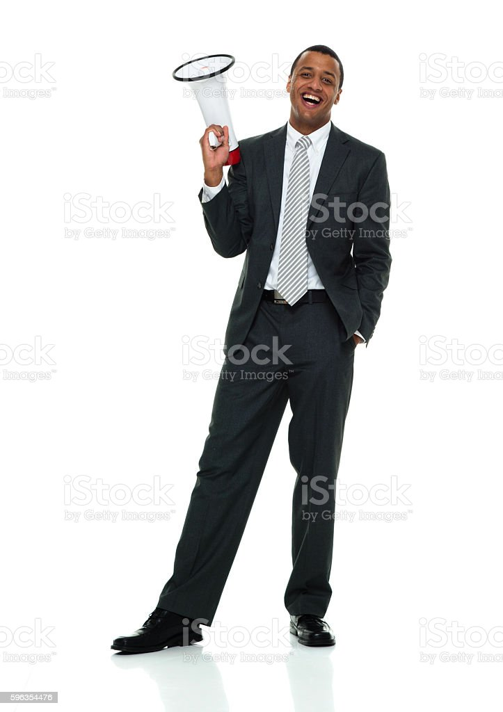 Smiling businessman holding megaphone royalty-free stock photo