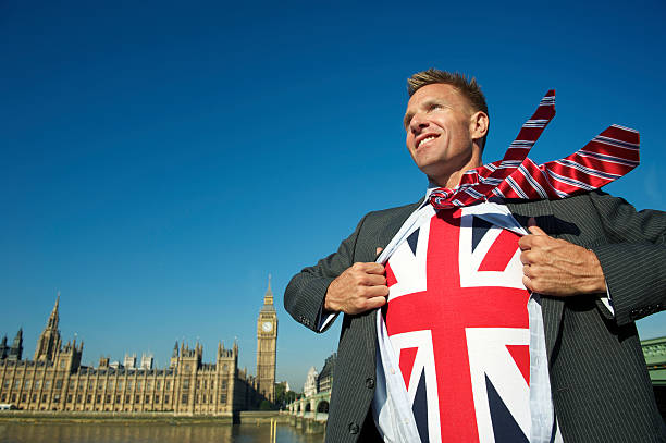 Smiling Businessman in London Reveals Patriotic Superhero stock photo