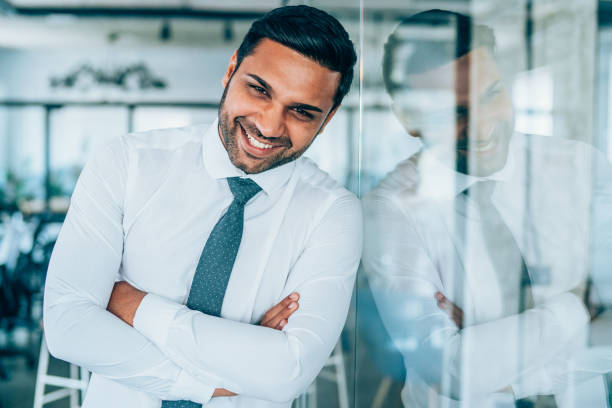 Smiling businessman in modern office picture id1189012393?b=1&k=6&m=1189012393&s=612x612&w=0&h=rmqacpzqzniq2rdu607sgye aywkqpqvs3eckahub6e=