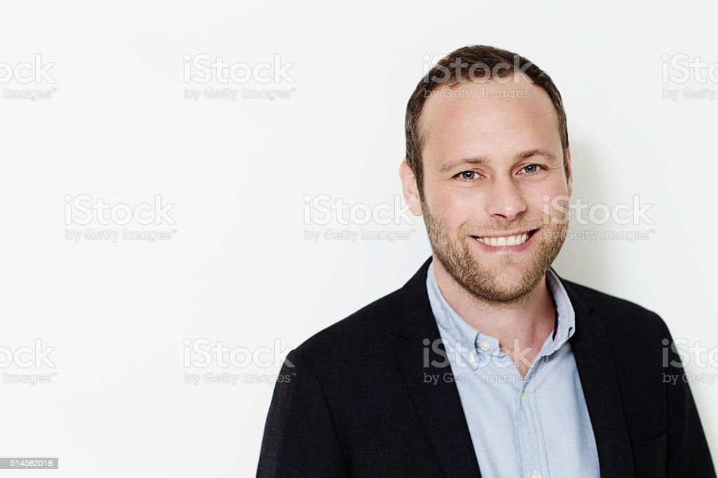 Smiling businessman in suit jacket stock photo