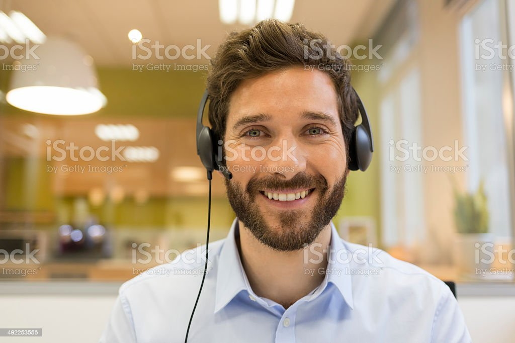 Smiling Businessman in the office on video conference, headset stock photo
