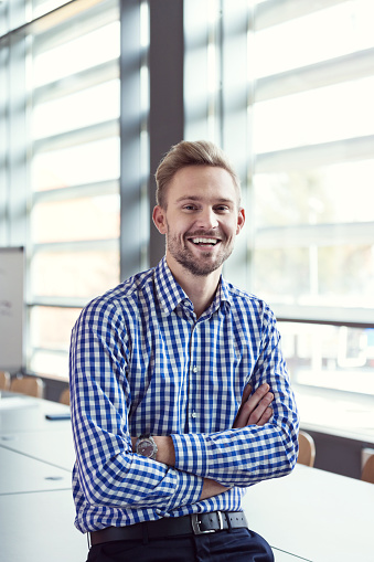 Smiling Businessman In The Office Stock Photo - Download Image Now