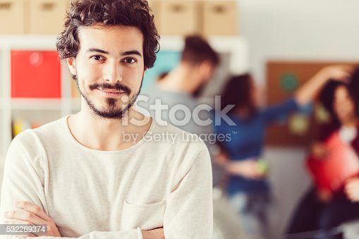 istock Smiling businessman in the office 532269374