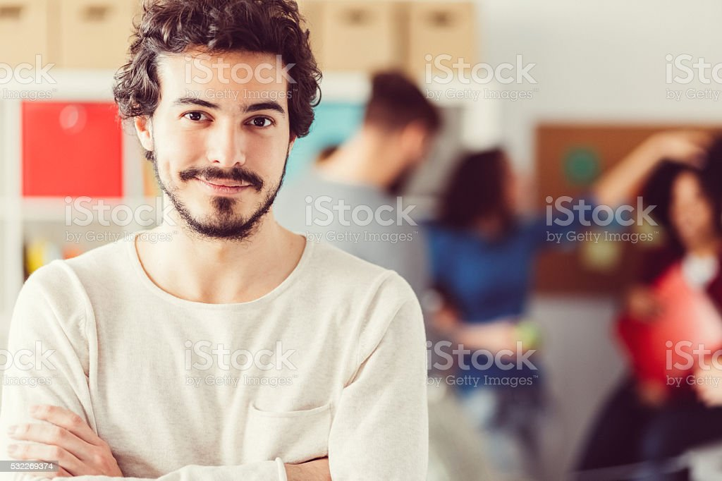 Smiling businessman in the office stock photo