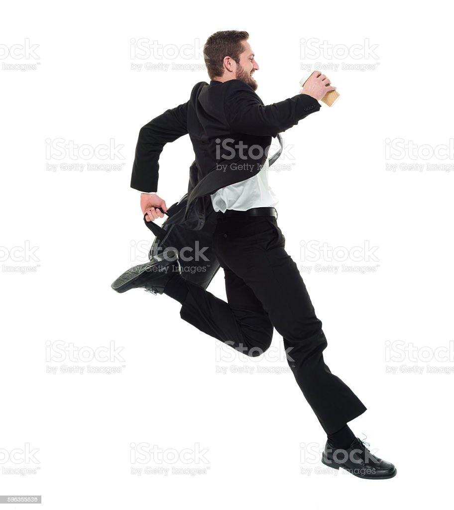 Smiling businessman jumping royalty-free stock photo