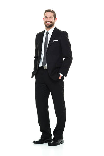 Smiling businessman looking at camera Smiling businessman looking at camerahttp://www.twodozendesign.info/i/1.png hands in pockets stock pictures, royalty-free photos & images