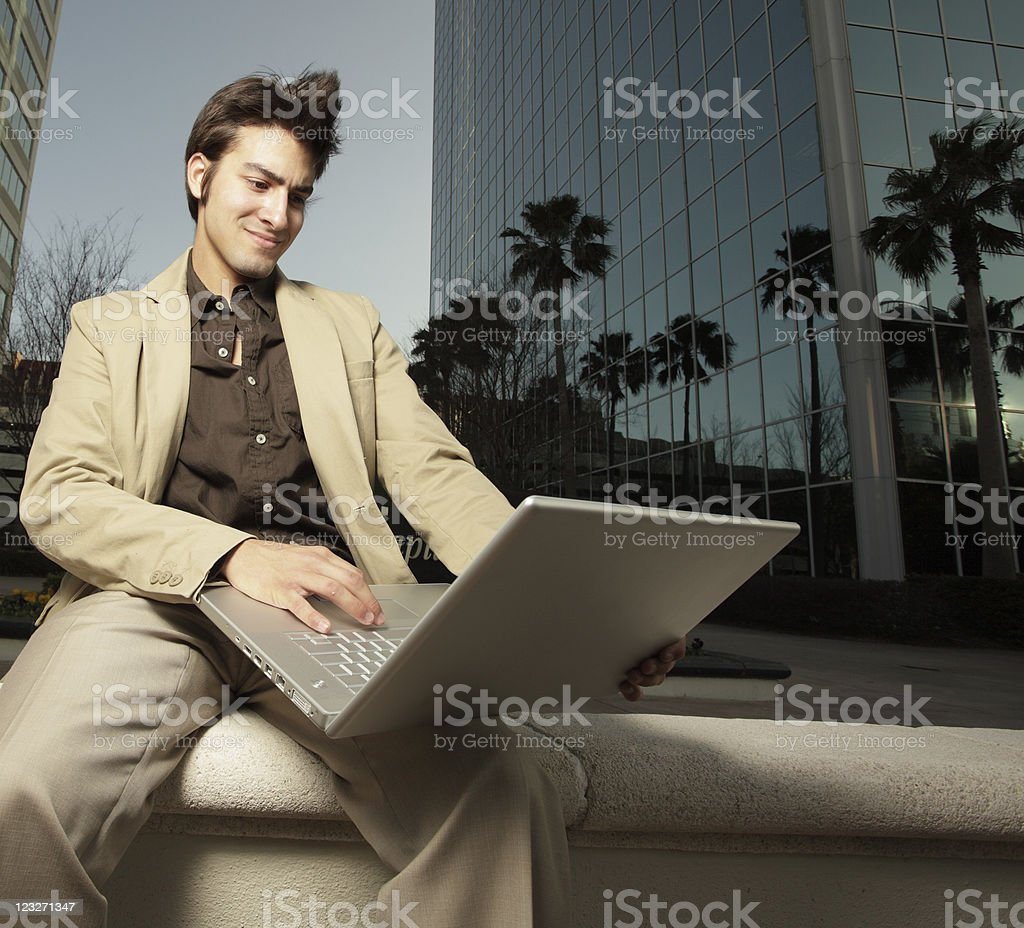 Smiling businessman on a notebook computer royalty-free stock photo