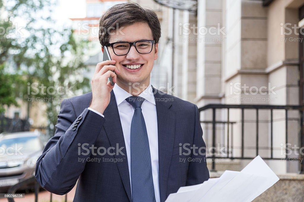 Smiling businessman on phone royaltyfri bildbanksbilder